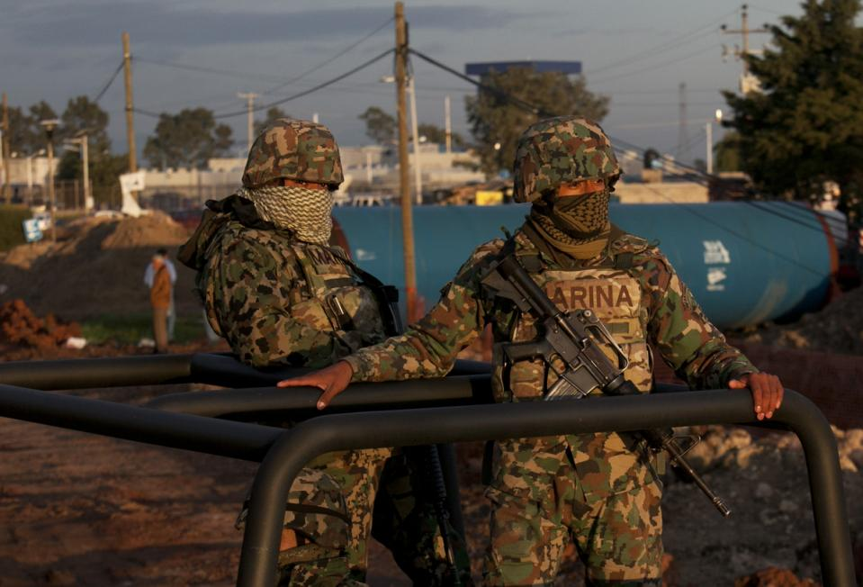"Mexican navy marines patrol near the maximum security prison Altiplano in Almoloya, west of Mexico City, Sunday, July 12, 2015. Mexico's most powerful drug lord, Joaquin ""El Chapo"" Guzman, escaped from a maximum security prison through a tunnel that opened into the shower area of his cell, the country's top security official announced. (AP Photo/Marco Ugarte)"